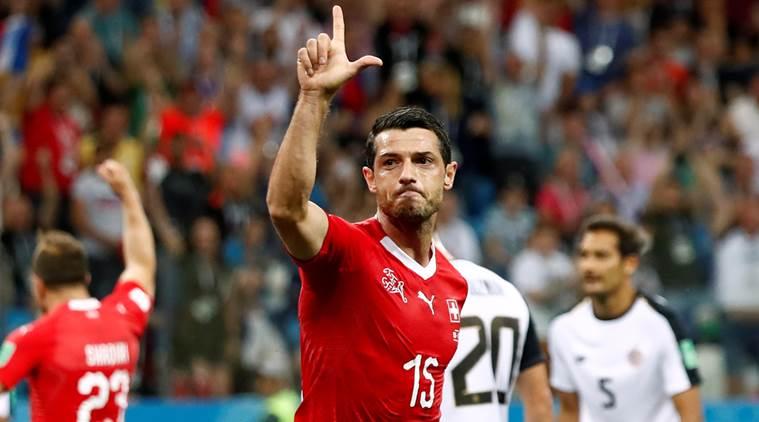 Brazil and Switzerland progress from Group E